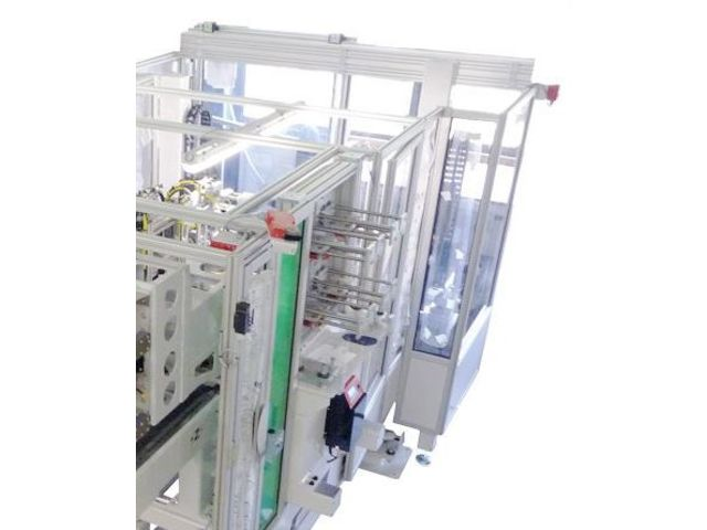 Label feeding system / automatic / for IML / for injection molding machines W837 TWIN  - product presented by WITTMANN BATTENFELD