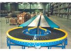 Curve of conveyor with motorized conical rollers.